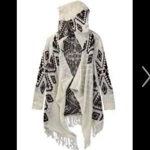 Poof Girl hooded open cardigan with fringe.